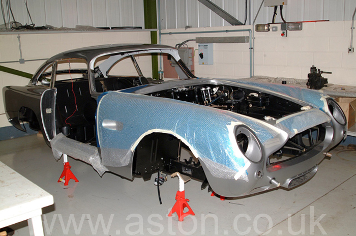 Many parts comprise an Aston Martin and they all have to come together in the right order.